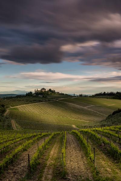 Tuscany vineyards dramatic clouds