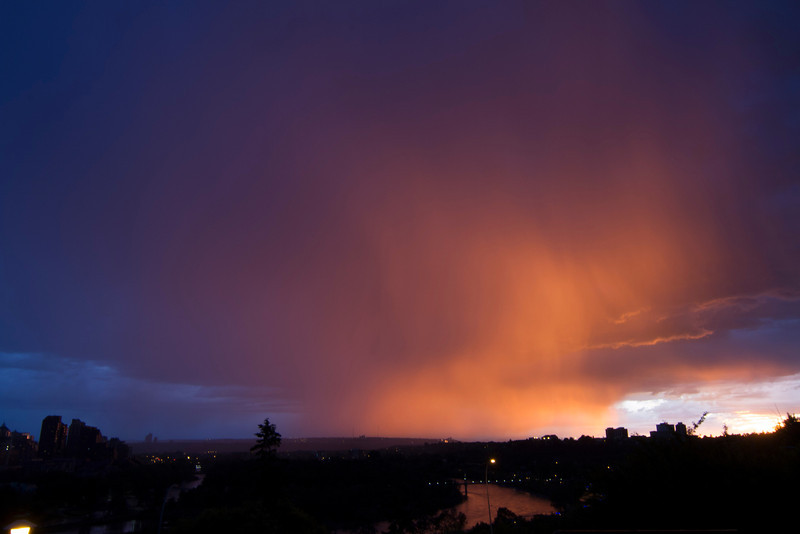 Oncoming Rain lit by the Sunset