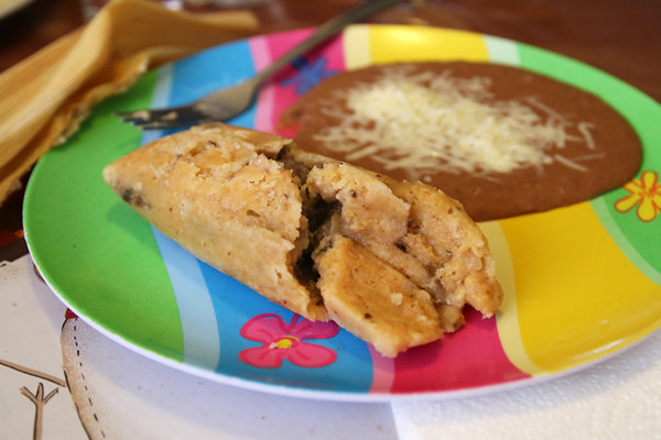 I like my tamales with some salsa (not yet applied) and beans