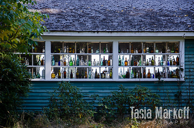 Someone collects colorful bottles