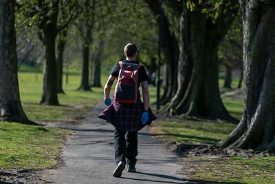Man walking to work in surgical gloves during lockdown in Harrogate, Yorkshire