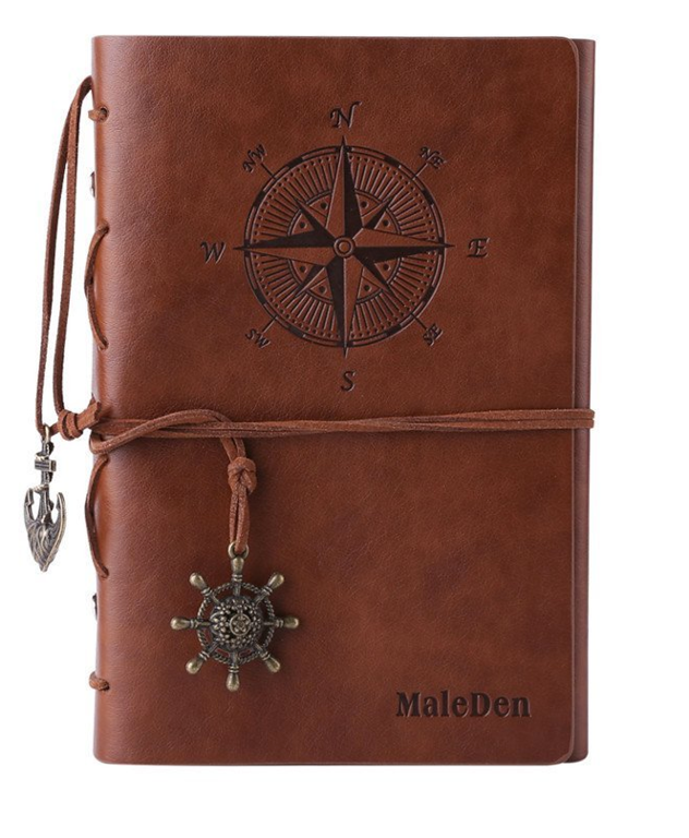 brown leather journal with compass binding