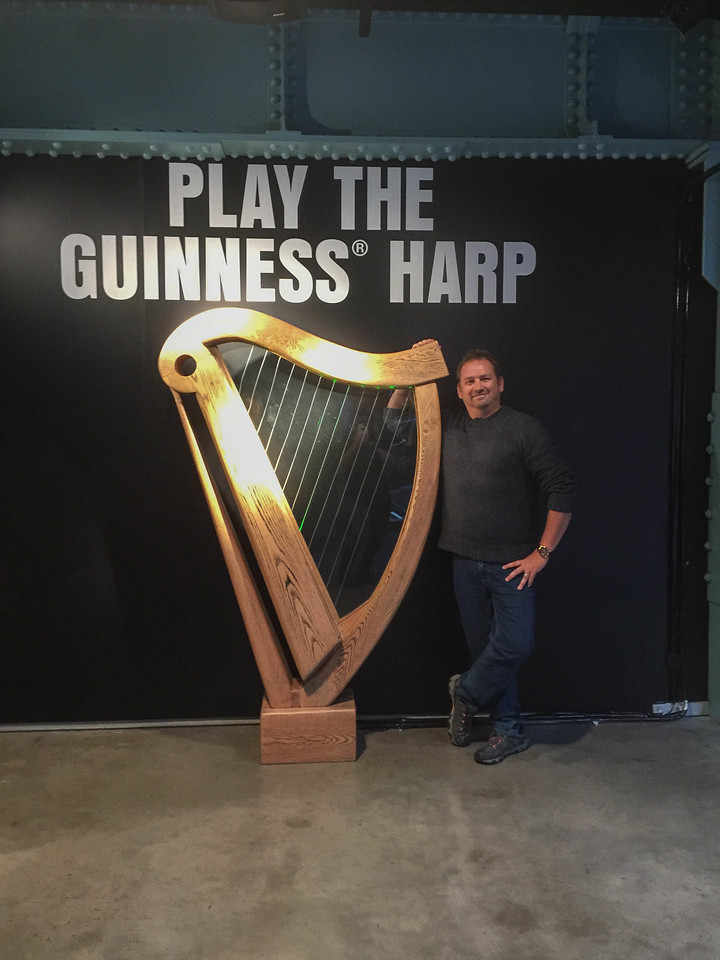 Playing the Guinness harp in the Guinness Storehouse