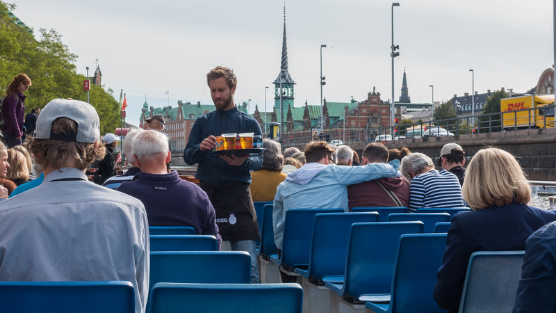 Serving beer on the Copenhagen Canal Tour