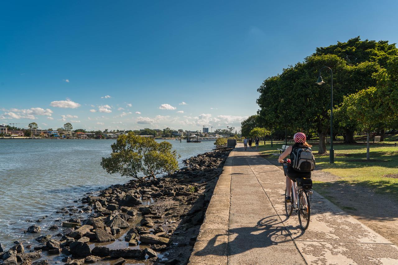 Cycling along the boardwalk in Brisbane