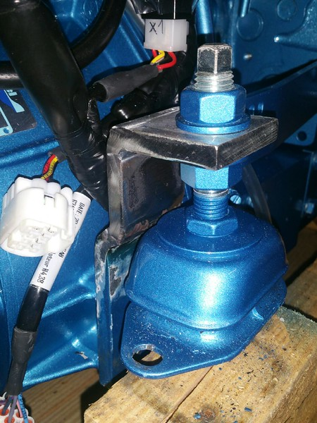 Engine mounts were modified to lower the engine