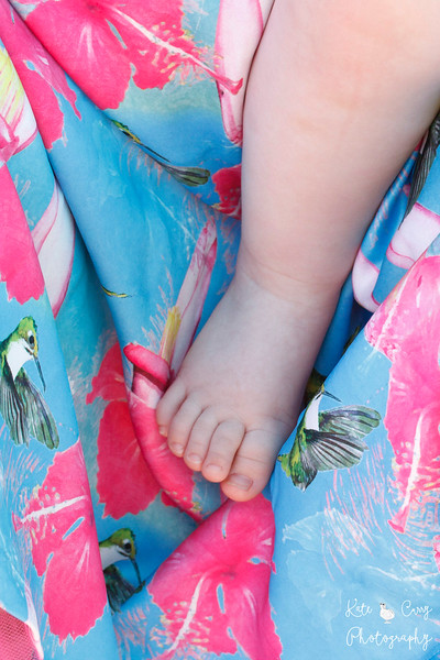 Baby's foot against mother's bright dress, Glasgow