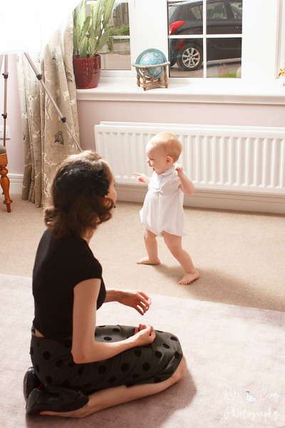Vintage styled baby taking some of his first steps and his mum, Glasgow.