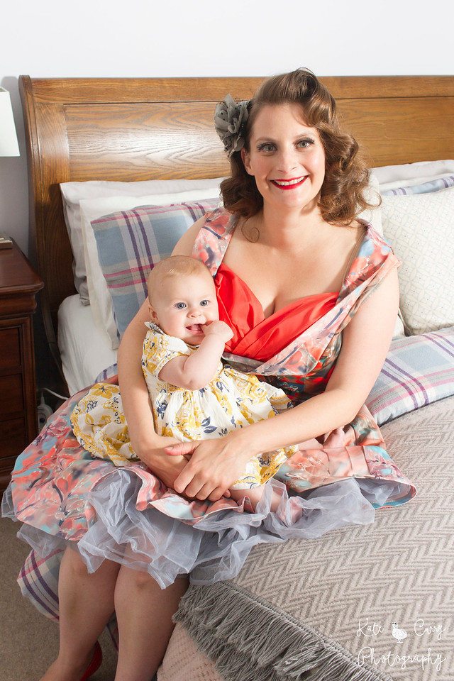Vintage styled mother and her baby daughter in a flowery dress