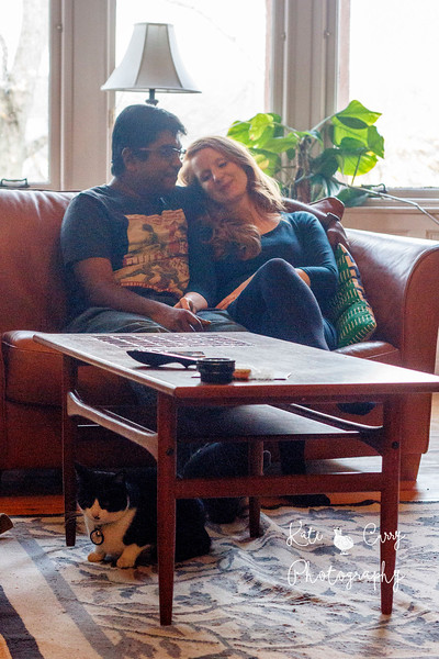 Couple relaxing on sofa together, with their cat. Glasgow