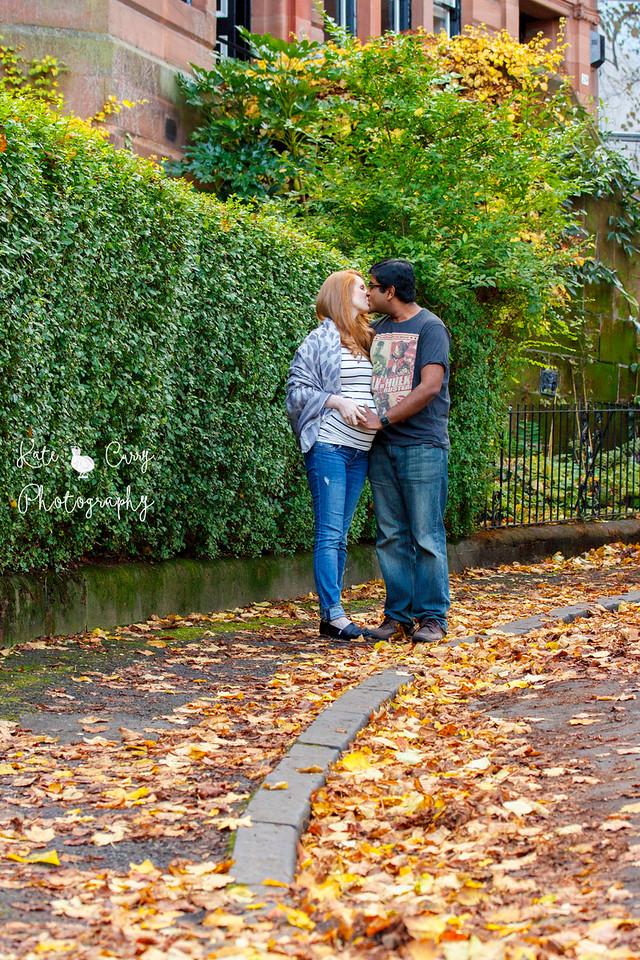 Pregnant couple, kissing outside their home, Glasgow
