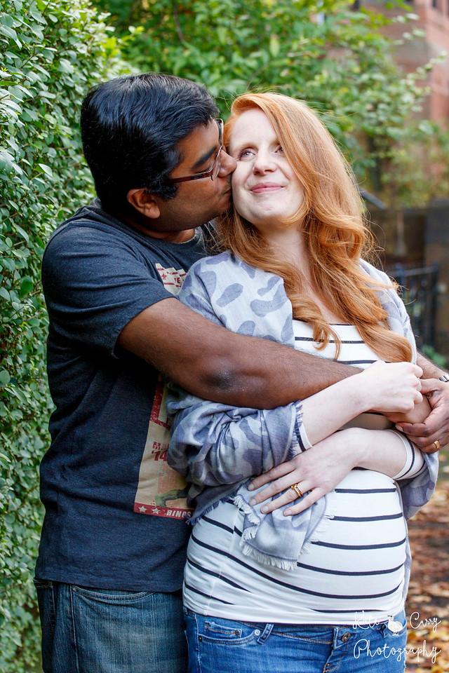 Expectant couple kissing, Glasgow