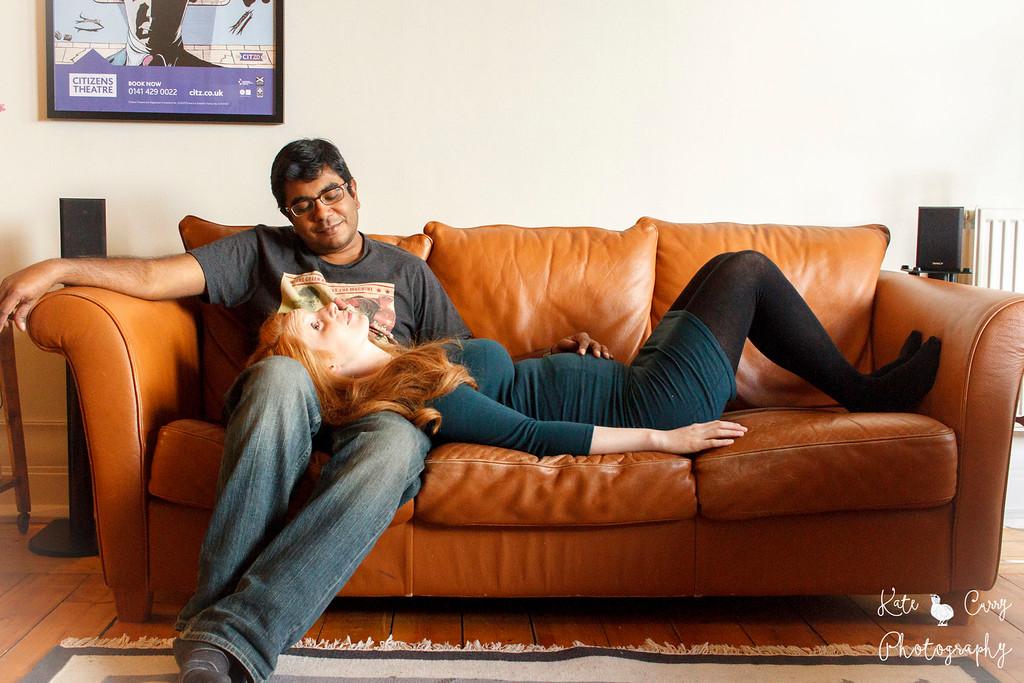 Expectant couple on sofa, Glasgow