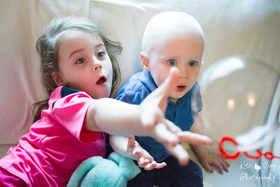 Glasgow siblings enjoy bubbles being blown