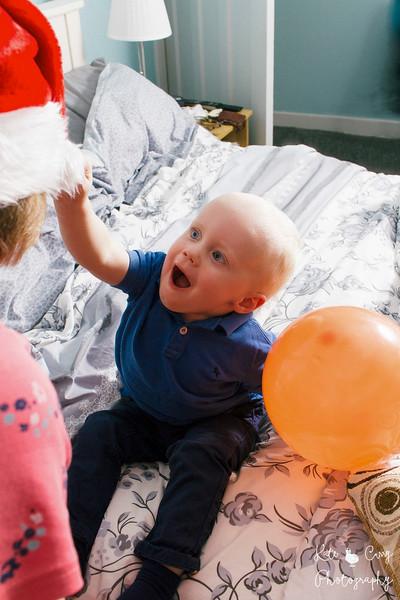 Toddler pulls santa hat off Grandma's head