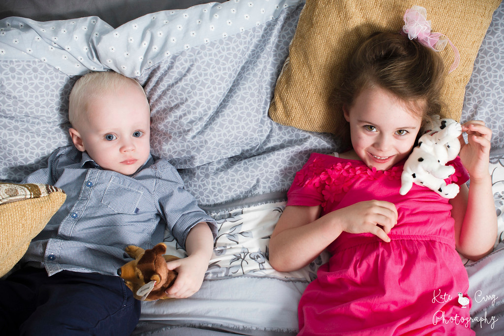 Siblings posing with cuddly toys, Glasgow