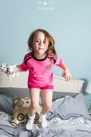 6 year old girl bouncing on grandparent's bed, Glasgow