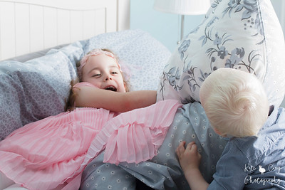 Two young siblings have a pillow fight, Glasgow