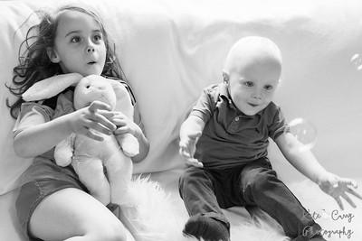 Grandchildren transfixed by bubbles, Glasgow