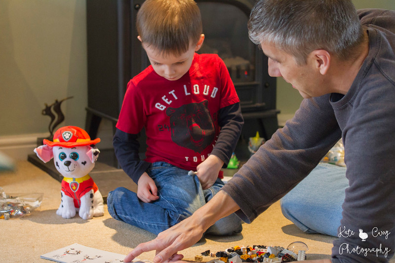 Father and son playing with Lego