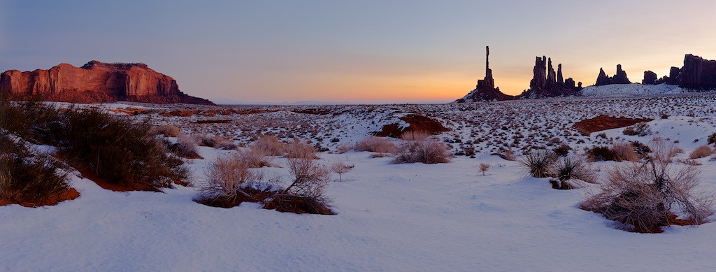 Totem Pole at Sunrise - Monument Valley, Arizona<br /> <br /> Merry Christmas everyone.  <br /> <br /> Above is an image I made while on vacation to Monument Valley between Christmas and New Years in 2009.  Among many reasons, I love this image because my family is with me--sister and brother in law--freezing their tails off like.  I'm not so sure they were as happy to be out there with me as I was, crazy brother doing the nature photography thing and all.  Still, lots to celebrate when you're with people you love in an environment you love.  <br /> <br /> Cheers<br /> <br /> Tom<br /> <br /> (update) ps - forgot to mention Vicki and Marks old friends (and my new ones) were freezin their tush's off as well when this scene was photographed.  In fact, they left Michigan to escape these temps in the teens when they retired to southern Arizona.  Somehow northern Arizona did not get the message they were vacationing with us and set the weather appropriately.  Thanks for being such troopers.