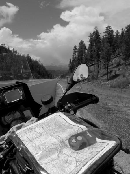 View From The Cockpit - Ruidoso, NM<br /> <br /> This next image is the view from my bike's cockpit.  The new thing in this map case which is on my new tank bag which is sitting just in front of my seat.  <br /> <br /> Right now there's nothing in there except what I had in the little map pouch I previously used.  I'm a little worried about how water-proof this bag might be.  Reading online some have said they've been very happy with it's water proofness.  Others, not so much.  A couple runs through the rain has so far been very promising, just a couple of drops inside the bag.<br /> <br /> I'm hopeful because I'd like to put my little portable camera in this tank bag for easy access.  We'll see