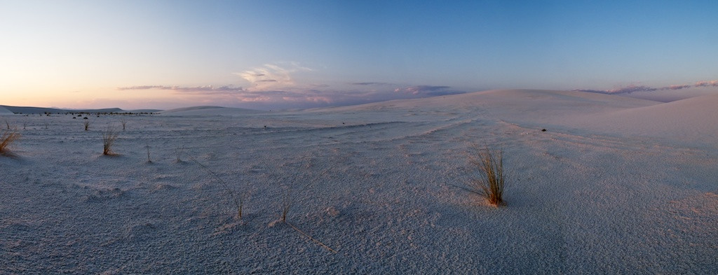 Whitesands at Sunset - Whitesands National Monument, NM<br /> <br /> I'm working an experiment.  The experiment is using a compact camera instead of my standard Nikon D3.  I'm about to go on a very long trip to the Northeast using my motorbike.  One thing I learned from my trip last year was I hardly ever used my very expensive and very large full-framed DSLR setup.  This time I'm hoping to get by with a very simple point and shoot compact camera.<br /> <br /> The camera I'm using is not so simple.  And it's not so compact compared to others.  It's the Canon G12 and among the P&S, it's gigantic.  Still, will it measure up?<br /> <br /> This title image was shot using this camera.  It's a standard--for me--four image panoramic put together on my computer back at home.  It looks pretty good.  It's not perfect, far from it.  But, it does a pretty decent job for such a little camera.<br /> <br /> One of the biggest issues with this camera because of it's sensor size is noise.  There's substantially more than there is with my D3 files in conditions like these.  The other thing is the flexibility of the Canon camera isn't nearly as great as my D3.  It is very difficult to shoot manual exposures and to adjust the focus manually and to do exposure bracketing.  In fact, it's impossible to do as it seems--at least for all three modes.  Anyway, I think I can work around it.<br /> <br /> One thing for example is focus.  Since it's such a small sensor, the depth of field is very large meaning I don't have to be so accurate on focus.  That's helpful as I think to shoot this way I'll not be able to use the manual focus feature of this camera when shooting landscapes.<br /> <br /> This is my first Canon camera.  I've always heard about the beautiful files they produce.  They sure are.  The color, contrast, and sharpness is very good.  I like it a lot.  Over all I think the camera is a winner.  I just have to get past the funky interface it has.