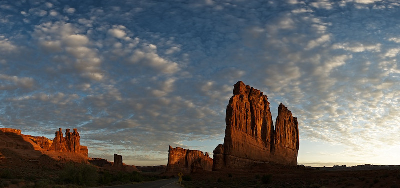 "Courthouse Towers - Arches National Park, Utah:  File # 1124061  <a href=""http://www.tom-hill.biz/Galleries/Scenics/Utah/20957775_CZGg5B#!i=1665224564&k=LVKdZ9M"">  Link To Original Image </a>  Of the many times I've been to Arches National Park, more often than not, I'm blessed with crystal clear skies.  While that makes for very pure imagery, having puffy, even popcorn like clouds adds a dimension that you don't get with clear skies.  This particular morning--my last in Moab this trip--I was blessed with just this.    AUGUST  The most significant photographic event of August was the acquisition of a new camera.  Not Nikon's latest and greatest digital SLR.  It was a simple point & shoot made by Cannon.  After much hemming and hawing over which small portable camera to buy, I bought the G12, Cannon's top of the line, semi-pro camera.  Really, it's a great little thing with lots of potential for many reasons.  Most importantly it's small and the sensor in good light does a great job.  This next image was my first attempt at panoramic photography using my new tool."