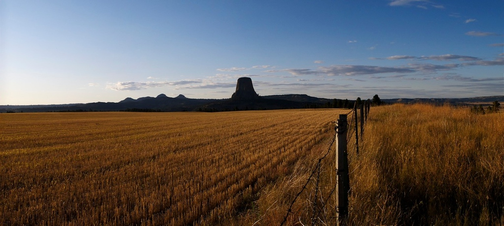 """Devils Tower at Sunset - Devils Tower National Monument: File# 1130296  <a href=""""http://www.tom-hill.biz/Galleries/Scenics/Elsewhere-Japan-Plains-Maine/20972581_TxHZrc#!i=1681635754&k=ddnB9TN"""">  Link To Original Image </a>  Where to begin on this second part of my photographic milestones of 2011.  You see starting at the end of September it was one gigantic photographic event after another.  I'm not quite sure I planned it just that way.  It just seemed to happen.  Or, maybe I'm just inclined to shoot during my favorite time of the year, the fall.  Who knows.  The only sure thing was I went all over the last three months of 2011 and have pictures to prove it.  The first major event was my Epic Ride to Maine beginning the middle of September.  The route took me from Alamogordo straight north to Devils Tower in Wyoming (no close encounters there though I did have a great camping experience on my birthday).  I then shot straight across the northen portion of the country to see my sister in Michigan."""