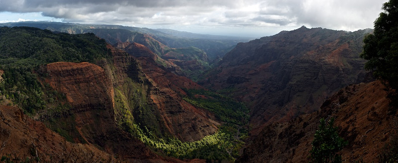 "Waimea Canyon - Kauai, Hawaii, File # 1124845  <a href=""http://www.tom-hill.biz/Galleries/Scenics/AlaskaMidwayHawaii/20952122_5BDLdT#!i=1664561951&k=fZFf9dG"">  Link To Original Image </a>  Waimea Canyon is commonly referred to as the Grand Canyon of the Pacific.  It is the largest and deepest in the Pacific.  That's a considerable accomplishment considering how large the Pacific is and how small Kauai Island is.   The light here is amazing.  Even though this image was shot at high noon, the light is subdued due to the ever present cloud cover.  Not 10 miles away from this spot is the most wet place on the planet.  In the distance you see a very dry, almost desert environment while not a few miles away it's raining cats and dogs all the time."