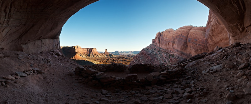 False Kiva At Sunset #2 - Canyonlands National Park, File # 1123927<br /> <br /> <br /> You see the dark and lighter portions are substantially different in terms of exposure.  Unfortunately, a manual compositor like I am requires some decided patience to get the edges between light and dark just right.  Well, I didn't have the patience meaning what I started in January wasn't finished until just now.  In fact, if it weren't for some new tools in Photoshop CS5 I might never have finished these images.  I'm happy I was able to.<br /> <br /> That improvement in technology is always a factor in digital photography.  I know some folks never look back at their images and continue to only work new technology on new images--i.e. never go backwards.  I appreciate that perspective but sometimes you just have to like I did here.  It's definitely more reasonable to go backwards when you hadn't really finished any versions previously--i.e. you're not repeating work.  In my case, I really was waiting for technology to improve enough so I could finish these images.  Makes me happy there's the constant march of progress in our photography world.<br /> <br /> Just a couple observations about the trail to this location.  This Kiva is located about 200 vertical feet below the lip of this plateau.  Up behind me and to the left is the way to the top of the plateau.  But, the path isn't straight.  In fact, this cave looking feature isn't really a cave.  It's merely a flat spot with an over-hang.  The path out of here is to the right.  It takes you below the lip of this flat part in front of me and towards the left to the steep, rocky (really loose rock) trail to the left.  Even when you've made the climb back to the top of the edge of the plateau the trail is not tall that well marked back to the street.  I, probably true to form, got slightly disoriented and hit the road a quarter mile away from my bike.<br /> <br /> One of these years, I'm going to make it back here during the right c