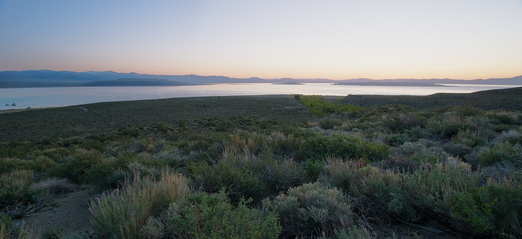"Gratuitous Sunrise Picture - Mono Lake, California, File #1216704<br /> <br /> WHAT TO DO WITH CREATIVITY<br /> <br /> As I already said, imagination is a non-linear process (thing didn't exist, then it does--i.e. non-linear).  Creativity is essentially the same.  When allowed to flourish, creativity allows transformation to occur.  Product that didn't exist suddenly does.  What wasn't considered possible suddenly becomes possible.  In the aviation business there are two tremendous examples.  The first is Kelly Johnson's Skunk Works.  This is the organization that brought to the aviation world the high flying U-2 60 years ago.  What's even more impressive today is the plane is still actively sought and used nowadays.  This was followed by the very fast and high flying SR-71 Blackbird.  The Mach 3 aircraft is the world's fastest ever air breathing manned aircraft.  It's an aircraft without compare.   The amazing things about these aircraft were both were designed, developed, then fielded in incredible secrecy.  What's even more amazing is both feats were accomplished in crazy short development cycles.  In some ways cynics will say we can't achieve the same accomplishments nowadays with our over-processed and constrained environments.  But, what if creativity was allowed to flourish with a group of imminently  qualified people?  You betcha, anything is possible.<br /> <br /> There's a small company in Mojave doing exactly that, Scaled Composites.  They're the company that brought you the Long-EZ.  Most recently, they flew the first commercial manned mission to near space and returned to win the X-Prize.  On that success, they're on the road to creating the first commercial with paying passengers, manned space operation.  As much as the cynics might comment about how we can't make the U-2 or SR-71, there we have Scaled Composites doing exactly that.<br /> <br /> Both of these organizations are characterized as having tons of imagination, creativity, and gobs of innovation.  And, they did it with incredibility few resources when compared to the more traditional aircraft companies building more traditional products.   <br /> <br /> Imagination, creativity, and innovation allows an organization to tackle the problems of the day whether they're product or process quickly and effectively.  <br /> <br /> CREATIVE VS COMPETENT<br /> <br /> You're reading this thinking I'm making a case for hiring painters and muscians to tackle your next project needing to build a new airplane.  That is not what I'm talking about.  In fact, I am saying as loudly as I possibly can that being creative is not exclusive of being technically competent.  Those in the engineering or less artistic fields are not devoid of imagination.  In fact, to me some of the most beautiful engineering solutions are art in their own sense.  It's just a matter of perspective.<br /> <br /> Let's think really basically in the physics world.  Let's imagine we're sitting under an apple tree in England enjoying one of the two sunny days.  While you're sitting there a damn apple falls on your cranium with a thud--THUD!  ""Oww"", you might exclaim.  As you're sitting there disrupted from the simple enjoyment of being out in the sun by that dang apple, you're hold it.  You consider it.  You're in silence.  Then, a thought begins to materialize.  How did the apple fall?  Why did it hurt?  There's substance involved with this apple.  There's substance to your cranium.  There's acceleration.  There's velocity.  I can only imagine what Newton felt when his laws came to solidify in his cranium.  If we could only see how it happened.  Next thing you know, we have one of the most important discoveries--Newton's Laws.  It's not like he found acceleration.  He simply was able to formulate a set of simple equations to model what he felt that day.  Really, it's beautiful when you consider how simple his laws are.<br /> <br /> What I'm describing here with Newton as the example is Competence is absolutely imperative if you're looking for innovation in a quality direction.  It also says being technically competent does not void you of your creative credentials.  These are not mutually exclusive.<br /> <br /> The possibility here is this.  If you have a project requiring new and different approaches to achieve success, for sure you call on imaginative, creative, innovative people to tackle the problem.  If your challenge is specialized, you involve people who are competent in their field but of course you verify they're creative so they're able to think beyond the norm to achieve success.<br /> <br /> Here's another spin on this subject.  Let's say what you're trying to achieve is not necessarily different but the environment that it operates in is constantly changing and variable.  Of course you know what that means.  It means you need creative people to tackle the project in these constantly changing and variable environments.  It's the same set of considerations.<br /> <br /> CONCLUSION<br /> <br /> Lots of stuff here isn't there?  Well, there's more.  The next article will discuss what your organization might look like.  It'll discuss how your organization is specially designed to eliminate variability in efforts to promote efficiency.  Unfortunately, this approach is precisely opposite of what's required to promote imagination, creativity, and innovation.  Unfortunately, what you might not realize is this effort to be more efficient to make your organization better is actually killing it.<br /> <br /> We noted here imagination, creativity, and innovation are involved in everything we do.  Whether be believe it or not all of these are necessary to do normal everyday activities.  To not have them means to not be able to do simple things like choosing which groceries to bring home.  Then again, to have them flourish in your organization means you may create new and innovative products in leaps and bounds.<br /> <br /> Cheers<br /> <br /> Tom"