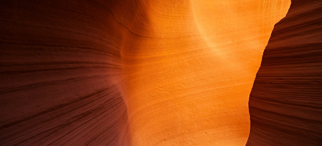 "CREATIVITY, IT'S NOT A COMPETITION SPORT - 21 JULY 2012<br /> <br /> Slot Canyon Colors - Lower Antelope Canyon, Page, AZ, File# 1230125<br /> <br /> The last couple of weeks I've been considering several different articles about creativity to discuss here on this blog.  I thought of a couple good ideas but unfortunately, none of them made it from my mind, through the keyboard onto the internet.  I'm not sure why I didn't produce any of those articles.  That is until I considered a couple things on my ride up here to Ruidoso.  The thing I thought about most was how competitive we seem to be and how even when we're being creative, there's some aspect of competition going on there.  I'm certainly not saying competition and creativity is bad.  But, I am saying you don't need to be competitive to be creative, hence the title, ""Creativity, it's not a competitive sport"".<br /> <br /> A few years back when the digital age was relatively new I was a member of a few different photography forums.  Back then, the whole internet thing was mostly new.  There certainly wasn't a Facebook.  There wasn't even Twitter.  Web 2.0 was still pie-and-the-sky-stuff if you knew anything about the internet.  Most of us that did participate  in these on-line forums were probably on the cutting edge of internet communication--meaning we could all have been termed geeks.  It's not a bad thing.  It's just what was.<br /> <br /> What I found most enjoyable in those internet forums was the tremendous ability to see other people's work.  I also got to display my own art.  Those days were awesome.  I remember checking the forums diligently especially when I posted one of my own pictures on-line.  I remember checking if anyone wrote a comment on my newly posted picture.  Mostly, I was looking for positive comments, the type that might rub you the right way.  If I got comments, great.  If I got glowing comments, really great.  If I got lots and lots of glowing comments, really really great.  I guess the measure of success was if the number of comments on my pictures were similar to those posted on the pictures of other photographers I respected and admired.  I figured if a picture generated a lot of buzz and comments, then there had to be a certain quality to the image to make people go out of their way to say something.<br /> <br /> After a while, the text of the comments were less important than the simple number of comments--good or bad.  I began to use the number of comments as the assessment of the picture.  And, that assessment had nothing to do with image's real quality.<br /> <br /> Clearly there's something not quite right when the quality check of an image isn't the image itself but something as disconnected as numbers of comments on an online forum.<br /> <br /> What was going on here?  Well, my desired feedback on these online forums transitioned from the words they wrote to simply ""I'm better than... (insert photographer's name here) because my images have more comments.""  It became a numbers game instead of opportunity to better the quality of my art through critiques.<br /> <br /> I guess what happened was instead of getting real honest and constructive criticism, I got simple short synopsis on the over-all quality--i.e. ""great, awesome, good job...""  Since I wasn't learning anything constructive with these comments, I think I changed my expectations to how I compared to the other photographers--i.e. it became a competition.<br /> <br /> Being creative is not a competition sport.  <br /> <br /> Sure there are lots and lots of competitions and judging opportunities out there for all forms of art.  Just cause there are so many doesn't mean it's the only way to express your creative talents.  On the contrary, what I found is if you try to create your art to satisfy some sort of competition, you lose control of your own art.  In those situations you're meeting someone else's quality standard, not your own.  As I've said many times before, the only worthwhile element in any piece of art is you, the artist.<br /> <br /> Here's another observation which you've heard before here; ""if you aren't willing to fail you'll never make anything really creative"".  What that means when you're in a competition to win, you aren't willing to come in last.  When you're accepting of the possibility your art might come in last, you're willing to try different things that might not ring well with the judges.  <br /> <br /> Okay, competitions are obvious win/lose contests.  That's not the only way to be competitive.  You might be competitive with yourself as in you're hell bent on doing your next piece of art better than the previous.  The same logic applies here.  You might actually find yourself frozen with that paint-brush barely floating above the canvas simply because you might not do as well as you think with that next brush stroke<br /> <br /> Do you remember finger painting when you were a kid?  If that was too long ago how about if you remember seeing your kids finger paint?  Do you think any of them were competing with their peers?  I remember just loving making and mixing colors.  I remember making a mess.  I remember loving the experience.  There was no competition.  There was simply the experience.  The win was to be there fully immersed.  You couldn't lose in other words.  It was fantastic.<br /> <br /> Somewhere along the line creativity became a sport.  If you consider this article, being competitive might mean we're making art that doesn't satisfy.  Even if you're not submitting to a competition and you're not satisfied with where you're going with your art, you might consider if you're competing with yourself.  It could be the reason you aren't satisfied is every step of the way you're second guessing yourself wondering if you're doing it ""right"".  I bet if you get away from the idea that everything you do has to be ""right"" you'll begin to relieve self-imposed constraints and begin to enjoy the experience of making art.  Remember, being creative is not a competitive sport, even if you're competing with yourself.<br /> <br /> Cheers<br /> <br /> Tom"