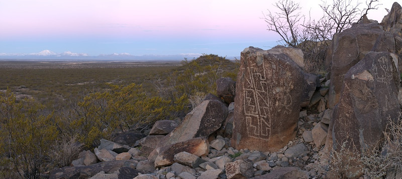 """Three Rivers Sunrise - Three Rivers Petroglyph, NM, File # 0703929  <a href=""""http://www.tom-hill.biz/Galleries/Scenics/New-Mexico/20953542_PwbVsq#!i=1664646766&k=6wkHjhD&lb=1&s=A"""">  Link To Original Image </a>  While I typically try not to repeat images at the risk of competing with myself or being redundant, I do like to return to places I hadn't been to in years just to see what else might be made.  You might be thinking to yourself, what difference could there be if you shoot from practically the same location using just about the same subjects?  What could you change?  In this case, the images where shot four years apart from each other.  The first was just last week.  The second four years ago almost exactly.    I think the images are substantially different in their portrayal of the scene.  While the major elements are essentially the same with the large rock petroglyph in the foreground and Salinas peak in the background, there's an obvious difference in weather--snow in one scene and not the other.  While there are clear skies in both images, the timing of the shots are different with the sun not quite illuminating the mountains in the lower image.    None of these difference are radical.  Yet, combined they make a completely different feeling image.  The details make the images completely different.  When I set my tripod up for the title image I did not reference the second image.  I did not have that image in my mind.  I simply knew I'd shot here previously which seemed to be the only connection between the two.  The differences between the two were my own prejudices, my own emotions, the thoughts occupying my brain that helped me make the choices I made to create the image.  Here's an interesting observation which really you all will need to help me assess.  I think the casual observer could tell both images were shot by the same photographer.  With the major elements begin similar, you might be able to conclude or guess both images were shot by the same """