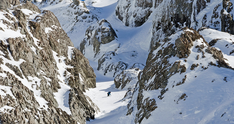 Tess riding the superb central couloir exit route from Mt Greenlaw