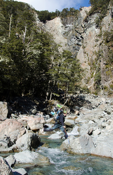 Tess boulder-hopping a side creek