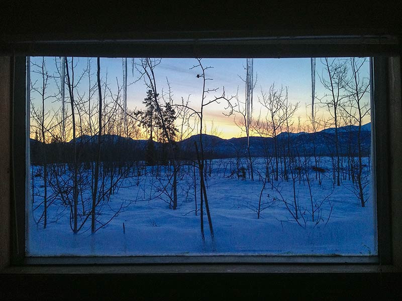 The view of sunrise from our cabin in Whitehorse, Yukon. (Photo: Kim Olson)