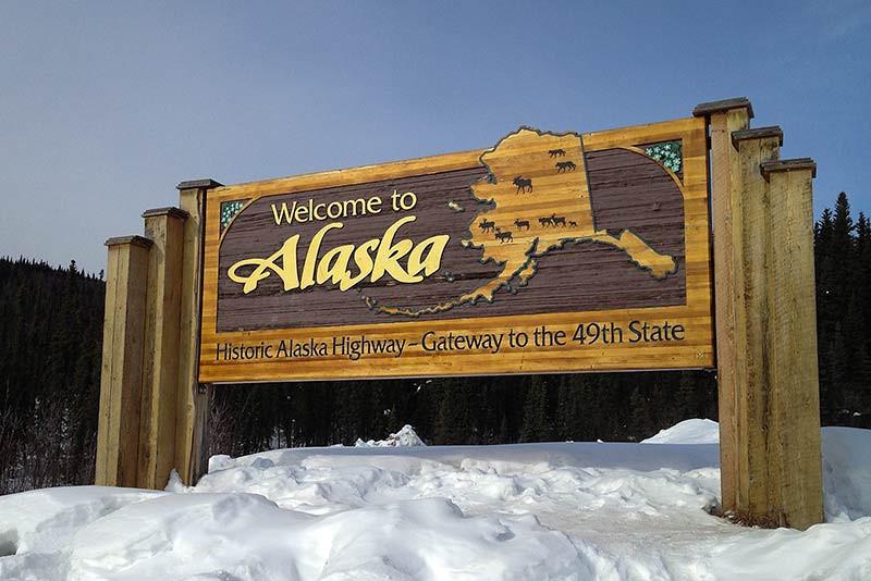 Welcome to Alaska sign along the Alaska Highway. (Photo: Kim Olson)