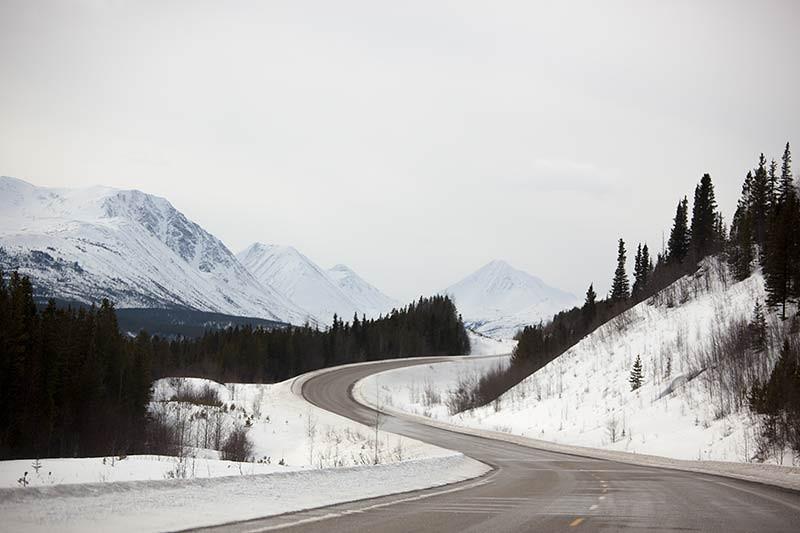 The snowy Rocky Mountains along the Alaska Highway. (Photo: Kim Olson)
