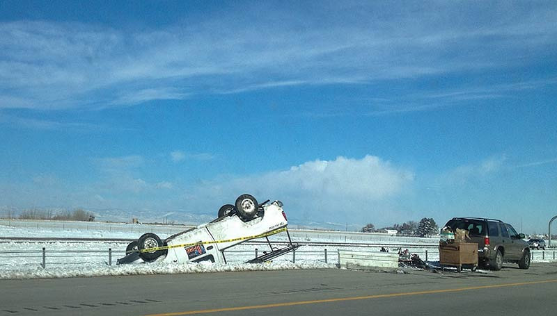 Overturned vehicle on I-25 north of Denver.