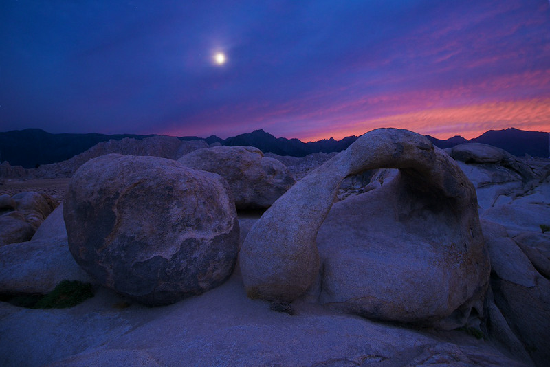 "ALABAMA HILLS SHOOTING DAY 2 - 3 August 2014<br /> <br /> Moon and the Mobious Arch - Alabama Hills, California<br /> <br /> Link to full sized version:  <a href=""http://www.tom-hill.biz/Galleries/Scenics/California/i-qJZFGZX/A"">http://www.tom-hill.biz/Galleries/Scenics/California/i-qJZFGZX/A</a><br /> __________<br /> <br /> I am just home from the short weekend shoot in the Alabama Hills.  It's barely noon here and I don't recall ever getting back so early from shooting the Eastern Sierra Mountains.  Not only that, I got home early enough to get in a bike ride.<br /> <br /> It's raining today.  I guess you could've figured that out from the clouds that were building last night.  As you can see in this picture, there were lots of clouds building.  <br /> <br /> The weather forecast said ""30% to 40% chance of rain.""  I guess that translates to ""100% chance of almost pouring down rain.""  The plan this morning was to shoot the arch at sunrise.  I woke.  I got dressed.  I opened the door with a start ready to march out into the parking lot.  Then, I noticed the pitter patter of rain hitting the ground.  It wasn't quite pouring but it was sure raining and I had no clue.  The darn air conditioner wall unit must've masked the sound so I was completely surprised when I opened the door.  Oh well... I turned around and went back to bed.<br /> <br /> Actually, I turned around and worked the photos from yesterday.  Here's the first of last nights images.  More to come.<br /> <br /> Cheers<br /> <br /> Tom"