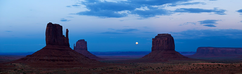 "MONSTER MOON RISE - 14 August 2014<br /> <br /> Moon Rise Between the Mittens - Monument Valley Tribal Park<br /> <br /> Link to full sized image:  <a href=""http://www.tom-hill.biz/Galleries/Scenics/Arizona/i-4tc83SX/A"">http://www.tom-hill.biz/Galleries/Scenics/Arizona/i-4tc83SX/A</a><br /> __________<br /> <br /> There has been a lot of hyperbole used when describing the recent full moons--Giant, Super, Monster.  Really, it's the same moon as it has been for billions of years.  It just happens to be at perigee in its orbit around the earth when its full.  The moon is on an elliptical orbit meaning in its travels there are times when it's closer than other times.  Perigee is when the moon is at its closest point in its orbit.  This is simple orbital mechanics.  It happens.  It's like predictable and you've probably seen it before and thought ""wow, the moon looks so obvious.""  And, yo probably didn't use super in your description.<br /> <br /> Words making it sound like it's the regular moon except on steroids don't have to be used to adequately describe whats going on (no drugs were involved in the size of the moon unless you happen to use them yourself).  I believe words such as ""super"" that emphasize the dramatic should be reserved for those times when it is special.  After all, what word do you use when there's truly something amazing going on, like a once in a lifetime event?  Do you use ""super awesome"" as a way to taking it to ""11""--if you've seen the movie, ""This is Spinal Tap,"" you'll understand what taking it to ""11"" means.<br /> <br /> I made my way to Monument Valley this past weekend to shoot the full moon.  It was a great night with clouds, color, and wonderful scenery.  Not everything came together just as I hoped.  The moon was too low in an obscuring haze when the last red light of the setting sun disappeared from the Mittens.  Still, it was a wonderful sight to behold.<br /> <br /> Cheers<br /> <br /> Tom"