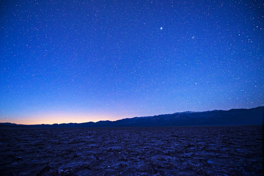 "JUPITER AND TELESCOPE PEAK - 29 December 2014<br /> <br /> Pre-Dawn Sunrise at Badwater - Death Valley National Park, California<br /> <br /> Link to original image:  <a href=""http://www.tom-hill.biz/Galleries/Scenics/California/i-HrgN6mb/A"">http://www.tom-hill.biz/Galleries/Scenics/California/i-HrgN6mb/A</a><br /> __________<br /> <br /> Here's a picture taken at the lowest point in the lower-48 states.  Badwater sits more than 200 ft below sea level.  When you first hear that number you think ""that's huge.""  But, when you park at Badwater and turn around to the steep cliff above the parking lot, there's a sign that says ""sea level.""  It sure doesn't see we're that much below sea level.<br /> <br /> I got to this point to correct my mistakes from the previous morning.  I slept in just a little bit and missed most of the pre-dawn stars that you see here.  My goal this particular morning was to correct my mistake and see what I could make.<br /> <br /> Originally I was simply trying to get the Telescope Peak mountain range making the western border of Death Valley with a bunch of stars.  When reviewing my images in the camera you could tell one of the stars was way more prominent than the others.  Checking my phone--i.e. there's a star app for that--I found the ""star"" was actually Jupiter which lined up pretty well with Telescope Peak, the portion of the mountain with all the snow.<br /> <br /> The star/sky portion of this image was shot about an hour and half prior to sunrise.  The foreground terrain was taken about 30 minutes prior to sunrise.  Of course, you can't see both of this in a single viewing with the human eye.  But, through the magic of Photoshop, I'm able to combine them to make the image you see here.<br /> <br /> This image was shot my last morning in Death Valley, a couple of hours before I did that bicycle ride that crossed the 5,000 mile threshold.  <br /> <br /> One more thing.  I was out there for at least an hour before the next car drove up.  By then there were hardly any stars meaning they missed what I created here.<br /> <br /> Cheers<br /> <br /> Tom"