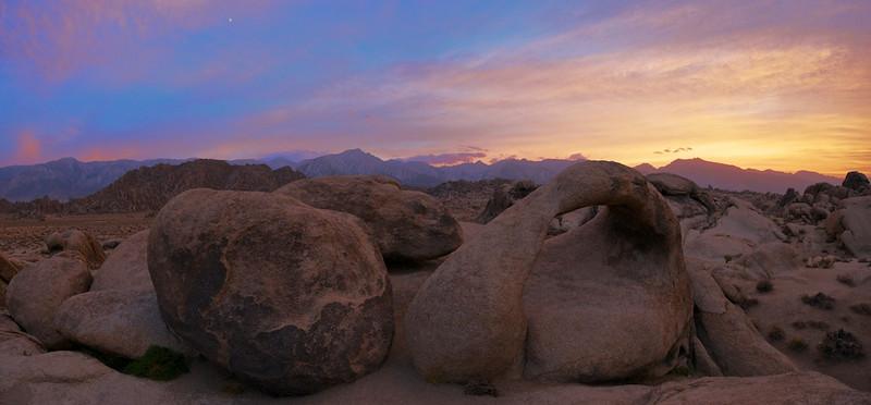 "Mobious Arch Sunset Day 2 - 7 August 2014<br /> <br /> Alabama Hills, California<br /> <br /> Link to Full Sized Image:  <a href=""http://www.tom-hill.biz/Galleries/Scenics/California/i-86pBgr9/A"">http://www.tom-hill.biz/Galleries/Scenics/California/i-86pBgr9/A</a><br /> __________<br /> <br /> When I started this particular shoot I wasn't very optimistic.  There was an approach rain storm.  The clouds were everywhere though they weren't thick.  I just didn't know how thin they were.  I was hopeful when the sun descended to the west that it'd be able to illuminate the clouds from below from beyond the horizon.  Turns out I was lucky because that's precisely what happened. <br /> <br /> If you look at the series of images I shot the first pictures were dull and gray.  Then for about 10 minutes I get this, beautiful bright color.  So much color it was bathing everything with a nice warm hue.  Even after most of the warm color disappeared, the sunset was still beautiful as shown by this image I posted a couple days ago:  <a href=""http://www.tom-hill.biz/Galleries/Scenics/California/i-qJZFGZX/A"">http://www.tom-hill.biz/Galleries/Scenics/California/i-qJZFGZX/A</a><br /> <br /> This image was made by with my new 14-24mm lens--which I'm very enthusiastic about, btw.  I shot two images by swinging the camera from left to right then stitching them together in Photoshop back at home.  The field of view here is quite wide, almost 180 degrees.  It's hard to tell but the arch is about 10 to 15 feet tall and it's only about 10 feet from the camera.<br /> <br /> Cheers<br /> <br /> Tom"