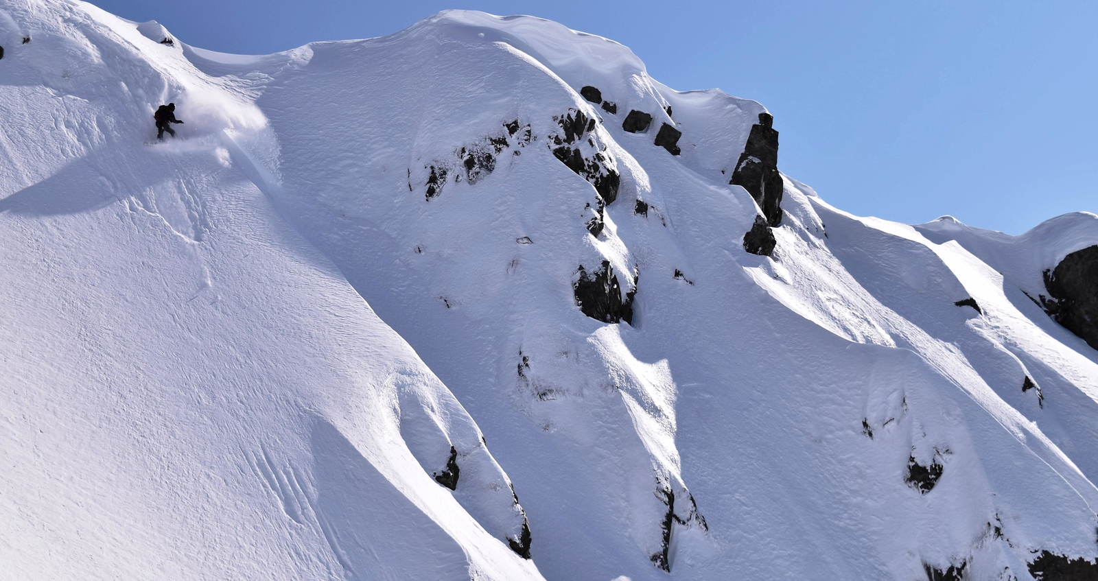 Tess Carney riding the east face of Mt Armstrong above Waimakariri Col