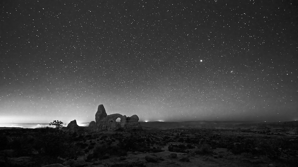 """""""BE CAREFUL""""--i.e. """"I LOVE YOU"""" - 31 January 2015<br /> <br /> Turret Arch and Jupiter at Night - Arches National Park, File# 1515291<br /> <br /> Link to Full Sized Image:  <a href=""""http://www.tom-hill.biz/Galleries/Scenics/Utah/i-gMHfWC4/A"""">http://www.tom-hill.biz/Galleries/Scenics/Utah/i-gMHfWC4/A</a><br /> __________<br /> <br /> I'm sitting in the local Starbucks towards the end of the holidays.  As I was sitting here watching the people come and go I got to thinking about whether any of them were traveling and whether they just left family or making their way back home.  I'm thinking about these travelers and my own experiences.  Then, I remembered when I was younger out on my own for the first time, why it mattered to my dad so much that I check in on whether I made it or not to my destination.  To me, it felt like a form of control to always check in, as in checking to my dad was somehow subverting my freedom.  I grudgingly accepted the situation but not without a bunch of grousing on my part.  Eventually I accepted things and moved on.  Interesting enough a couple years ago I got a totally different perspective on this need to look out for loved ones.  I realized it's not about control, not in the least.  All it's about is love.  Let me explain.<br /> <br /> Control is about making someone conform to your will.  It's about power.  Love is about wanting the best for the other.  Most people can imagine that when it's about controlling someone, there's very little love involved.  <br /> <br /> A couple years ago I was flying a mission in New Mexico.  I think we were doing a flight not a hundred miles north of where I used to work at Holloman AFB.  Like most military aircraft our C-12 had lots of radios to listen to practically anything we wanted.  Normally, you set one radio to a controlling agency to coordinate your clearance and flight path.  The other radios were normally used to coordinate miscellaneous things associated with the mission.  Since we didn't """