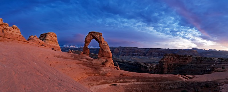 """MORE DELICATE ARCH - 25 January 2015<br /> <br /> Blue Sky at Sunset with Delicate Arch - Arches National Park, File# 1515218<br /> <br /> Link to Full Sized Image:  <a href=""""http://www.tom-hill.biz/Galleries/Scenics/Utah/i-6K2VjMp/A"""">http://www.tom-hill.biz/Galleries/Scenics/Utah/i-6K2VjMp/A</a><br /> __________<br /> <br /> Most of the time when I shoot scenics, I'm lucky to get one passable image.  On really special days, I might get two.  Sessions when I get three distinct keepers are definitely memorable.  This particular day with Delicate Arch will be memorable.<br /> <br /> Between the subject, the clouds, the light, and the almost lack of crowds will make this particular shooting session very memorable.  In this case, I have at least two, maybe even three """"Best of 2015"""" worthy images.  I almost couldn't have taken a bad image that whole evening.<br /> <br /> The neat thing about this particular image is it's all one exposure value.  It's three images shot in a pano that I merged together digitally.  I didn't combine different exposures to get the final product.  My camera's sensor was more than adequate to capture what you see here.  All I had to do was adjust the tone values to realize what I """"saw"""" when I pushed the shutter button.<br /> <br /> It's very special times like this that makes me think about my day job.  If my day job wasn't so awesome, I'd probably be pointing towards something involving more nature photography.<br /> <br /> Cheers<br /> <br /> Tom"""
