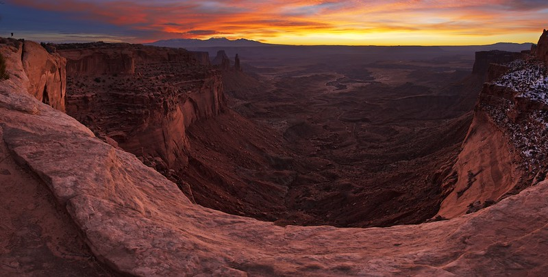 "MORE MOAB IMAGERY - 29 January 2015<br /> <br /> Sunrise over Mesa Arch - Canyonlands National Park, File#  1515025<br /> <br /> Link to Full Sized Image:  <a href=""http://www.tom-hill.biz/Galleries/Scenics/Utah/i-Kv67gP3/A"">http://www.tom-hill.biz/Galleries/Scenics/Utah/i-Kv67gP3/A</a><br /> __________<br /> <br /> I already posted a representation of the iconic view of Mesa Arch in Canyonlands National Park earlier this week.  As I've been known to do, I've looking other directions for new and different views at iconic locations.  It's my effort to make a unique interpretation that's been done countless times before.  In this case, I simply climb the rocks just to the left of Mesa Arch.  <br /> <br /> Truly, the landscape from this location is spectacular without even considering the arch.  Just the view across the basin here over the Colorado River to the distant La Sal mountain range is amazing.  The interesting thing is I'm not sure until this particular moment had I ever looked beyond the arch to see what's there even though I've been to this location about a dozen times.<br /> <br /> Sometimes we get so focus'd on what's directly in front of us we might miss other slightly more subtle opportunities just nearby.  I guess there's nothing wrong with that.  The lesson this particular image brings me is always look for the other angle even though what you have right in front of you is plenty amazing by itself.  You might find a gem that no one else as discovered.<br /> <br /> Cheers<br /> <br /> Tom"