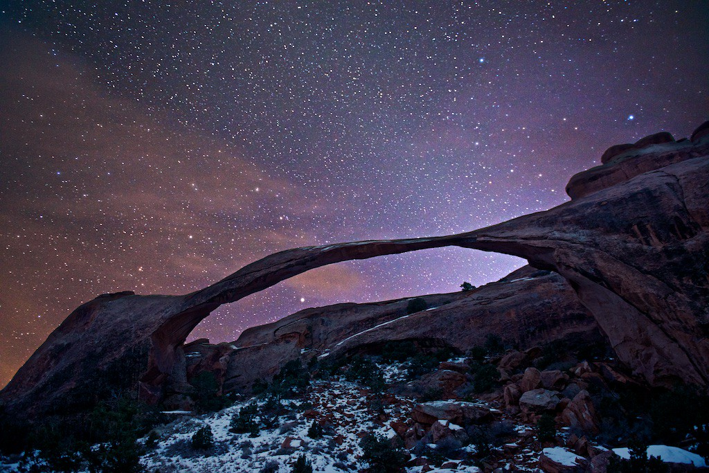 "MORE ARCHES NATIONAL PARK - 19 January 2015<br /> <br /> Landscape Arch at Night - Arches National Park, File# 1514955<br /> <br /> Link to full sized image:  <a href=""http://www.tom-hill.biz/Galleries/Scenics/Utah/i-LHrJwXw/A"">http://www.tom-hill.biz/Galleries/Scenics/Utah/i-LHrJwXw/A</a><br /> __________<br /> <br /> (Editor's note;  updated image with better tone adjustments)<br /> <br /> Here's today's image.  I'm still on my trip to Arches National Park.  This particular site is Landscape Arch.  If I'm not mistaken, this particular arch has the world's longest span.  It's over a hundred meters.  Just over 20 years ago a large portion of the arch collapsed.  I believe the very large boulders to the right of the arch at its base are the results of that event.  Since then, the National Park Service closed the trail directly underneath the arch.<br /> <br /> Of course, this particular location is touted as being better at sunrise than at sunset.  That's 100% true since it's open slightly towards the east allowing morning light to directly touch the arch.  Me being me, I wanted to create something a bit different involving stars.  In this case I captured image data not long after sunset--the foreground portion.  The background star field was captured about an hour and half after sunset.  No, it isn't possible to see this particular scene with a well defined foreground and bright stars in the background with out own two eyes.  This type of image is only possible through the magic of post processing that can combine light from when it's brighter out and when it's darker.<br /> <br /> Cheers<br /> <br /> Tom"