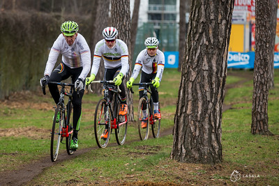 A German coach and his riders rolls through a wooded section during the pre-ride at the Cyclo-cross World Championships on January 29, 2016 in Zolder, Belgium. Photo: Matthew Lasala